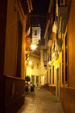 Narrow street in Sevilla at night Royalty Free Stock Image