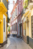 Narrow street in Seville Stock Photography
