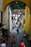 Narrow street in Sighisoara Royalty Free Stock Image