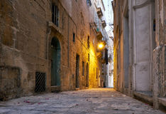 The narrow street Is - Sirena on Senglea in the early morning. M Royalty Free Stock Image