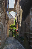 Narrow street in a small French village Vallon Pont d'Arc. The narrow street in the small French town of Vallon Pont d'Arc Royalty Free Stock Photo