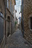 Narrow street in the small French village Vallon Pont d'Arc. The narrow street in the small French town of Vallon Pont d'Arc Royalty Free Stock Image