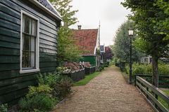 The narrow street in the small village of Zaanse Schans. The narrow street in the small village of Zaanse Schans, the Netherlands Royalty Free Stock Photos