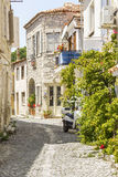 Narrow street with stone old houses stock images