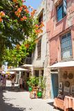 Narrow street with souvenir shops in the old town of Chania stock photos