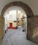 The narrow street in spanish city Cadiz stock photo