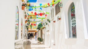 Narrow street in a spanish town Royalty Free Stock Images