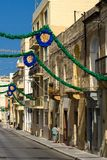 Malta, Streets of St Pauls Bay. Narrow street in a small Maltese town during festa preparation before feast day of its saint patron, St Pauls Bay, San Pawl il Royalty Free Stock Image