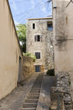 Narrow street with staircase in an old village in southern Europ Stock Photography