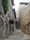 Narrow street with staircases of stone in slope of the medieval suburb of Sermoneta in the Lazio in Italy. Narrow street with staircases of stone in slope of Stock Photo