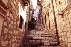 Narrow street with stairs Stock Photos