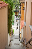 Narrow street with stairs and lamps Royalty Free Stock Image