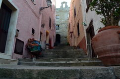 Narrow street with steep stairs leading up the hill towards Doria castle Stock Images