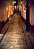 Narrow street in Stockholm at night Stock Images