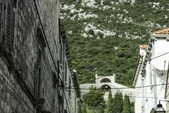Narrow street in Ston with Great Wall in background in Ston, Croatia. Narrow street in Ston with Great Wall in background in Ston, Dubrovnik - Neretva, Croatia Royalty Free Stock Photography