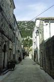 Narrow street in Ston with Great Wall in background in Ston, Croatia. Narrow street in Ston with Great Wall in background in Ston, Dubrovnik - Neretva, Croatia Royalty Free Stock Photos