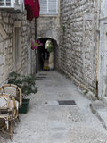 Narrow street with stone pavement Stock Images