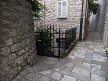 Narrow street with stone pavement Royalty Free Stock Images