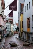 Narrow street in Tallinn's old town. TALLINN, ESTONIA - NOVEMBER 25: Narrow street in Tallinn's old town in a cold Autumn morning, Estonia, on November Stock Photos
