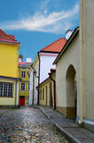 Narrow street in Tallinn. Narrow street with cobblestones in the old town of Tallinn, Estonia Stock Photo