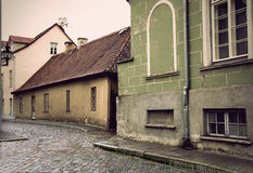 Narrow street in Tallinn. Narrow street with cobblestones in the old town of Tallinn, Estonia Royalty Free Stock Images