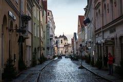 Narrow street in Tallinn old town. TALLINN, ESTONIA - NOVEMBER 25, 2017: Narrow street in Tallinn's old town in a cold Autumn morning, Estonia Stock Photography