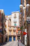 Narrow street of Tarragona with colorful living houses Royalty Free Stock Images