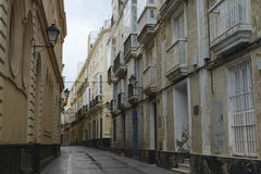 Narrow street with traditional architecture in Cadiz Stock Photo