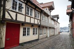 Old town street. Flensburg, Germany. Narrow street with traditional colorful living houses in old town Flensburg, Germany Stock Photography