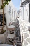 Narrow street with traditional white houses in Parikia, Paros royalty free stock images