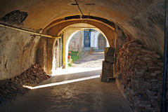 Narrow street tunnel Stock Photography