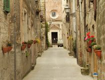Narrow street in Tuscany, Italy Stock Photo