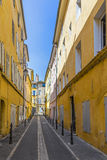 Narrow street with typical houses in Aix Stock Image