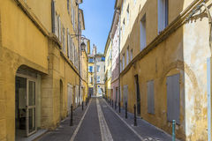 Narrow street with typical houses in Aix Stock Photo