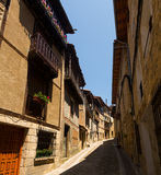 Narrow street with typical houses in Frias. Burgos stock photo