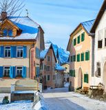 Narrow street with typical houses in the older part of Guarda at sunny winter morning, Inn District, Swiss canton of Graubunde royalty free stock photo