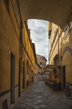 Narrow street with typical italian houses in Lucca, Tuscany Royalty Free Stock Photography
