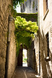 Narrow street in Uzes, France. Narrow lanes surround the castle in the Languedoc village of Uzes. Originally Ucetia, Uzès was a small Gallo-Roman oppidum, or Stock Images