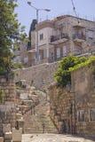 Narrow street in the Vadi Nisnas Quarter, Haifa, Israel. Haifa, ISRAEL - May 24: A residentional street in the Vadi Nisnas Quarter, on  May 24, 2014, in the old Royalty Free Stock Photos