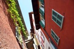 Narrow street of Varenna town Stock Images