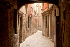 Narrow street in Venice. Narrow street and gang in Venice Italy Royalty Free Stock Photos