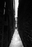 Narrow street in Venice bw Stock Photo