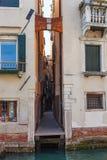 Narrow street in Venice city in spring Stock Image