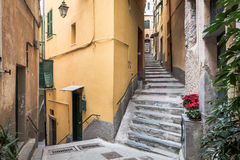 Narrow street of Vernazza town at Cinque Terre national park in Italy Royalty Free Stock Images