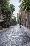 Narrow street of Via Luigi de Maio in Sorrento. Sorrento, Italy - August 31, 2016: Paved narrow street of Via Luigi de Maio in touristic italian town Royalty Free Stock Photos