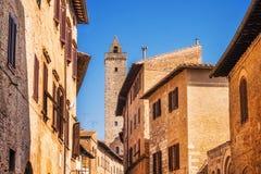 Narrow Street Via San Giovani and Cuganensi Tower in San Gimignano, Tuscany Stock Photography