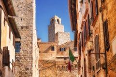 Narrow Street Via San Giovani and Cuganensi Tower in San Gimignano, Tuscany Royalty Free Stock Image