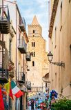 Narrow street with view on Cathedral of Cefalu Sicily stock images
