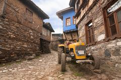 A narrow street view of 700 years old Ottoman village. The historical texture of the village has been well protected. The village Royalty Free Stock Images