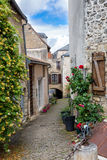 Narrow street in the village of Angles-sur-l'Anglin Royalty Free Stock Photo